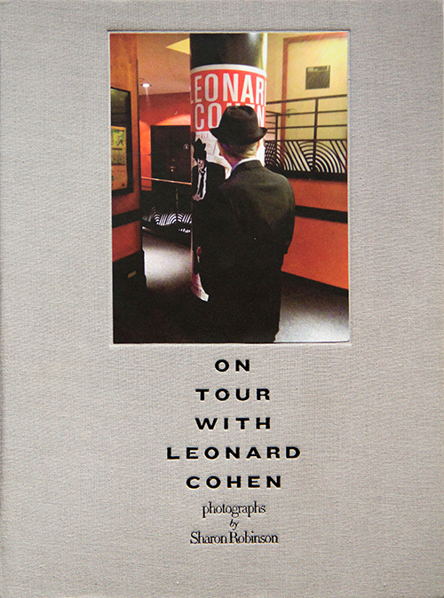 "On Tour with Leonard Cohen documents the wildly successful Leonard Cohen World Tour through the eyes of his friend and longtime collaborator, Sharon Robinson. In 2004 Cohen's manager stole his life savings, forcing him out of planned retirement into what has now become a legendary six-year sojourn.Sharon Robinson has been associated with Cohen since the Field Commander Cohen tour of 1979-80, first as a singer and subsequently as his co-writer and producer. She was drafted into the current iteration of Cohen's band, The Unified Heart Touring Company, from the onset, and has literally been at his side for over 400 shows. Robinson has captured her experience behind the scenes with the complete freedom afforded her by her unique position.On Tour with Leonard Cohen is an impressionistic view of what it was like to be on tour with the legendary singer-songwriter poet. Robinson reveals the nitty-gritty of day-to-day life of the road, onstage and behind the scenes, and the chemistry of Cohen and his supporting artists, together on an incredible journey across the globe, their hearts and minds focused on the next show. - Purchase ""On Tour with Leonard Cohen"" on Amazon."