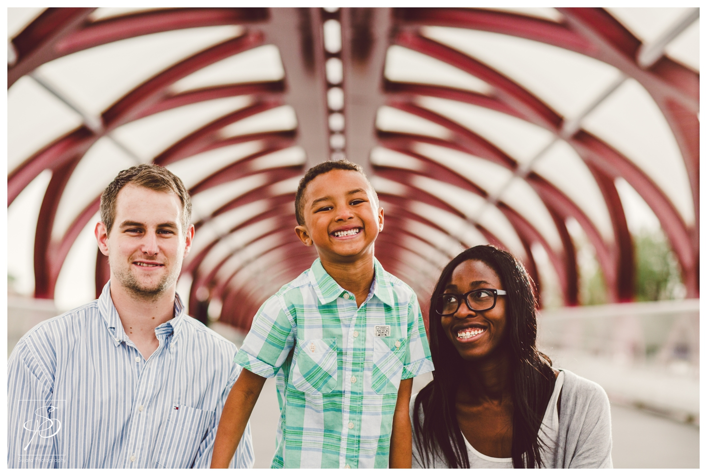 Family smiling on Peace Bridge Downtown Calgary