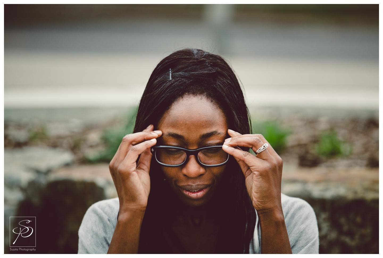 Woman adjusting glasses Downtown Calgary