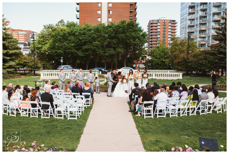 Garden wedding ceremony at Lougheed House in Calgary