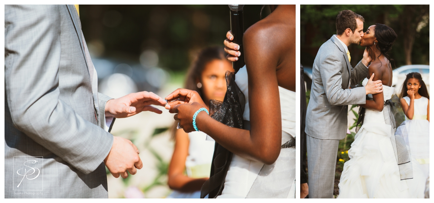 Bride and Groom exchanging rings during their garden wedding ceremony at Lougheed House
