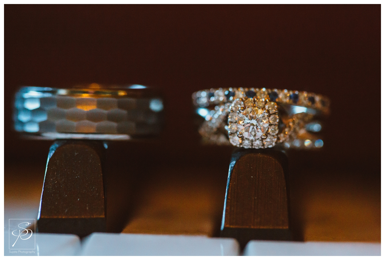 Wedding rings on piano keys at Lougheed House Calgary
