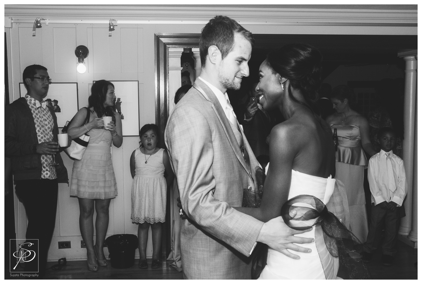 Bride and Groom with guests during their first dance at Lougheed House Calgary