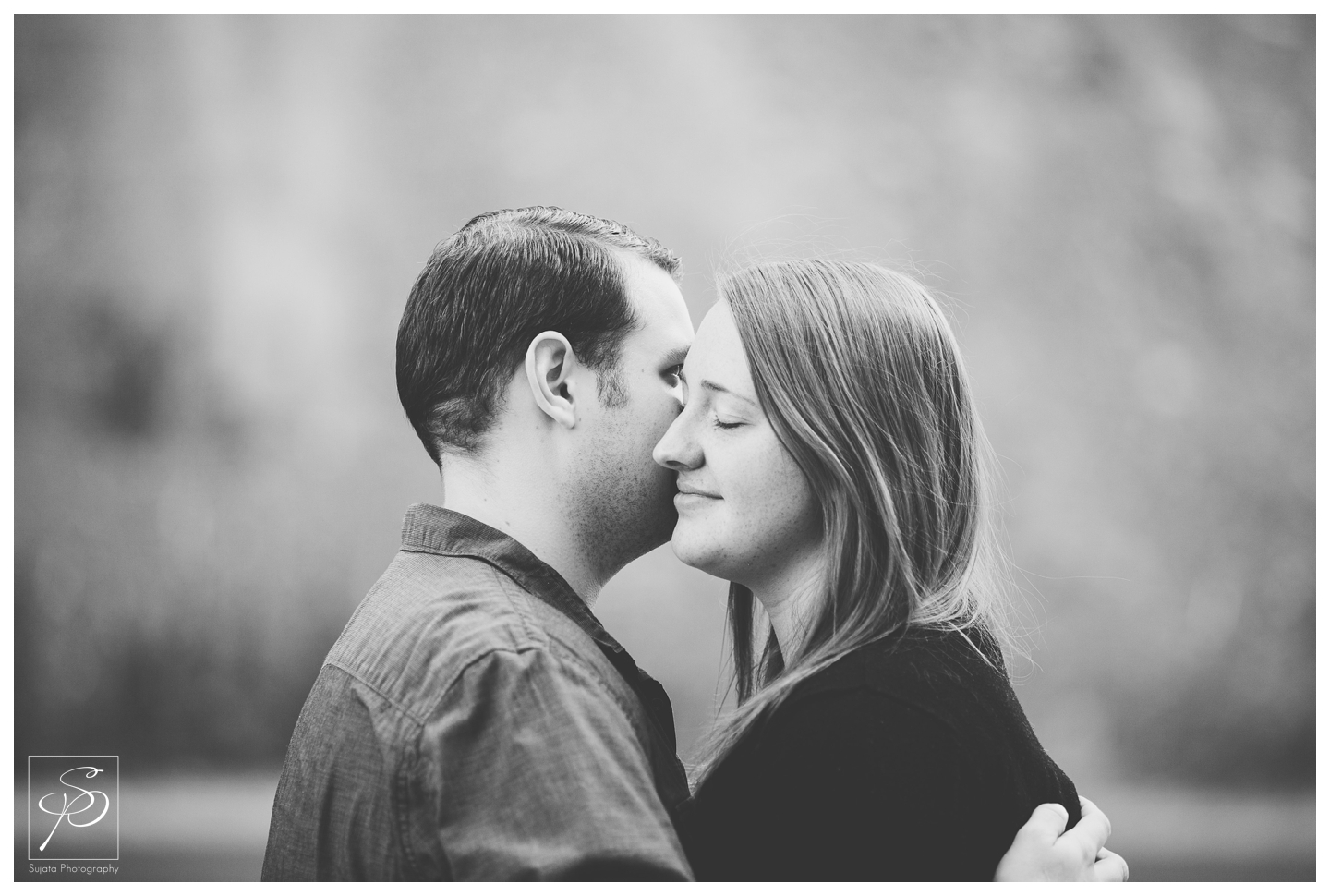 Couple embracing during their engagement session in Canmore