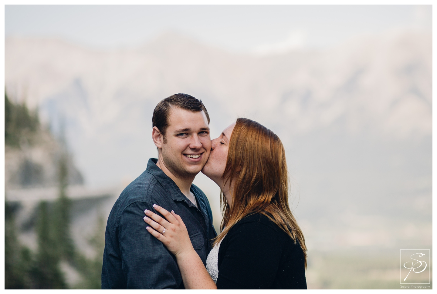 Couple sharing kisses during the engagement session in Canmore