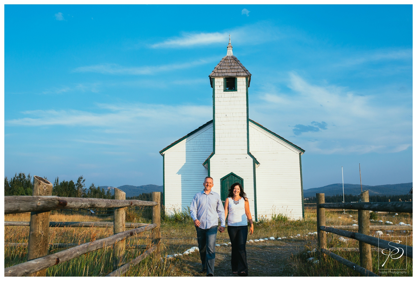 Couple outside of a chapel in Ghost Lake
