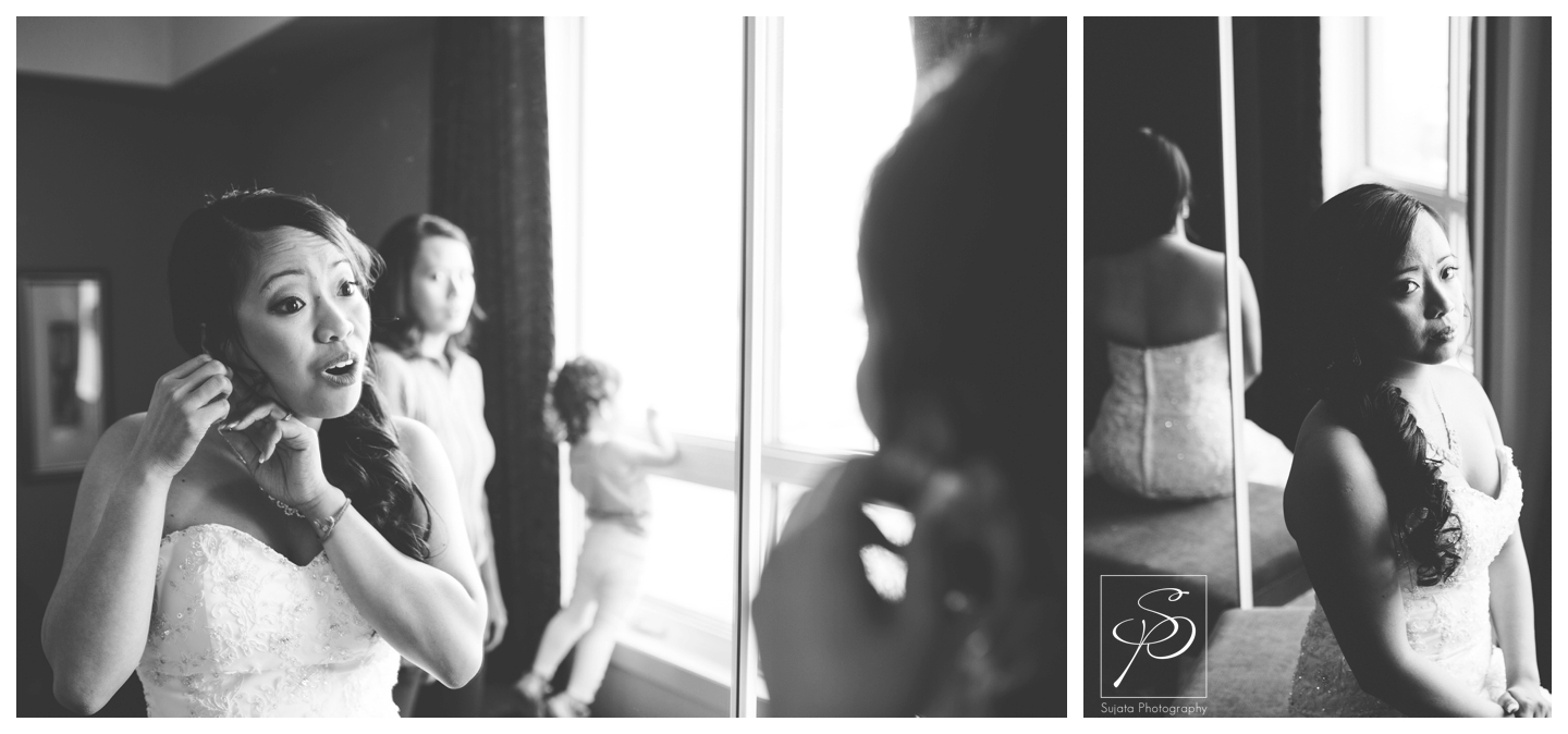 Black and white portrait of bride getting ready for Catholic wedding ceremony