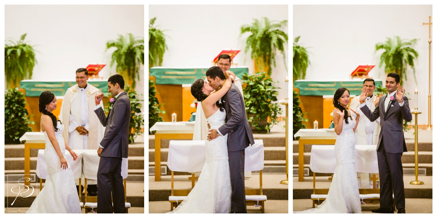 Couple's first kiss during Catholic Ceremony St. Thomas More Calgary