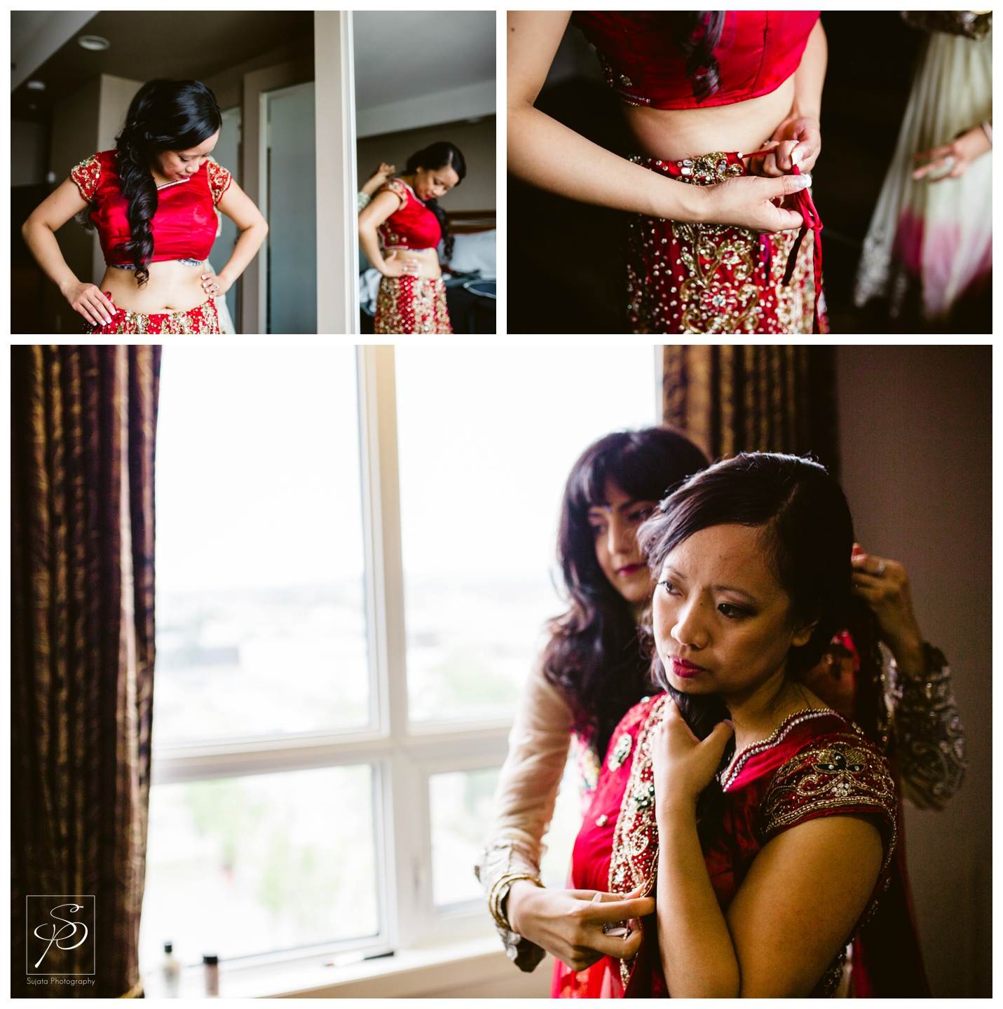 Bride putting on red sari for her Hindu wedding ceremony