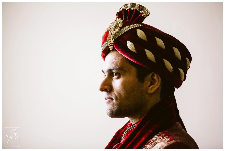 Groom preparing for East Indian wedding ceremony Executive Royal Inn Calgary