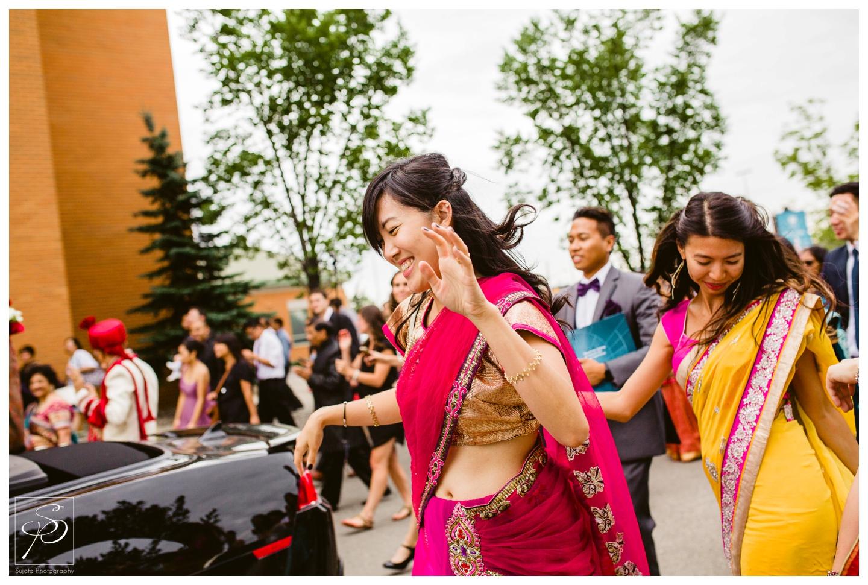 Guestsin saris dancing during East Indian Barat