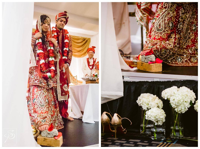 Bride with foot on stone during hindu wedding ceremony Executive Royal Inn Calgary
