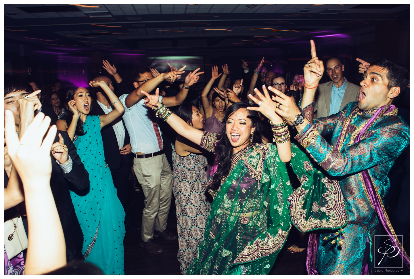 Bride and Groom dancing with guest at Calgary wedding reception