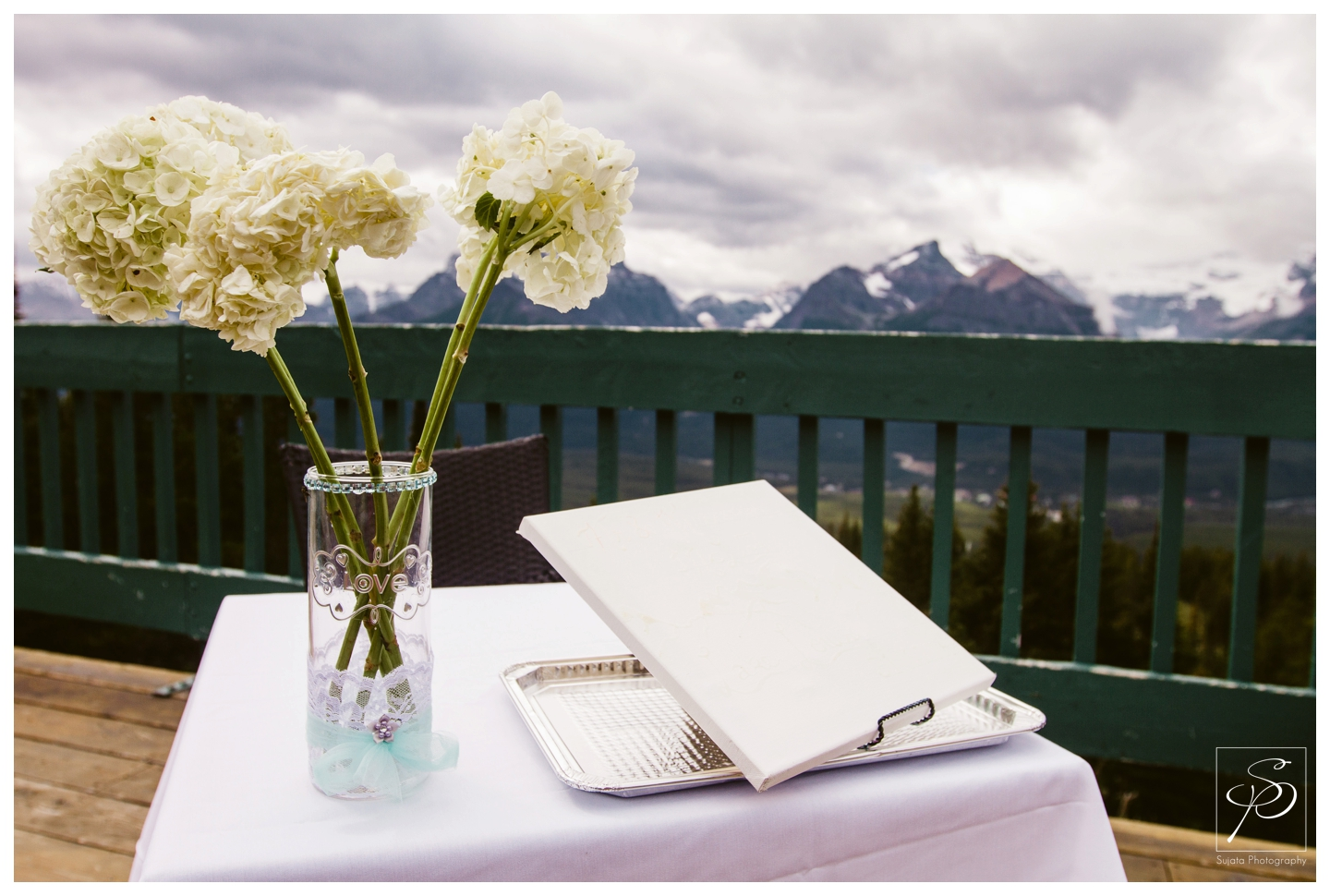 Flowers and signing table with mountain view at Lake Louise Ski Hill