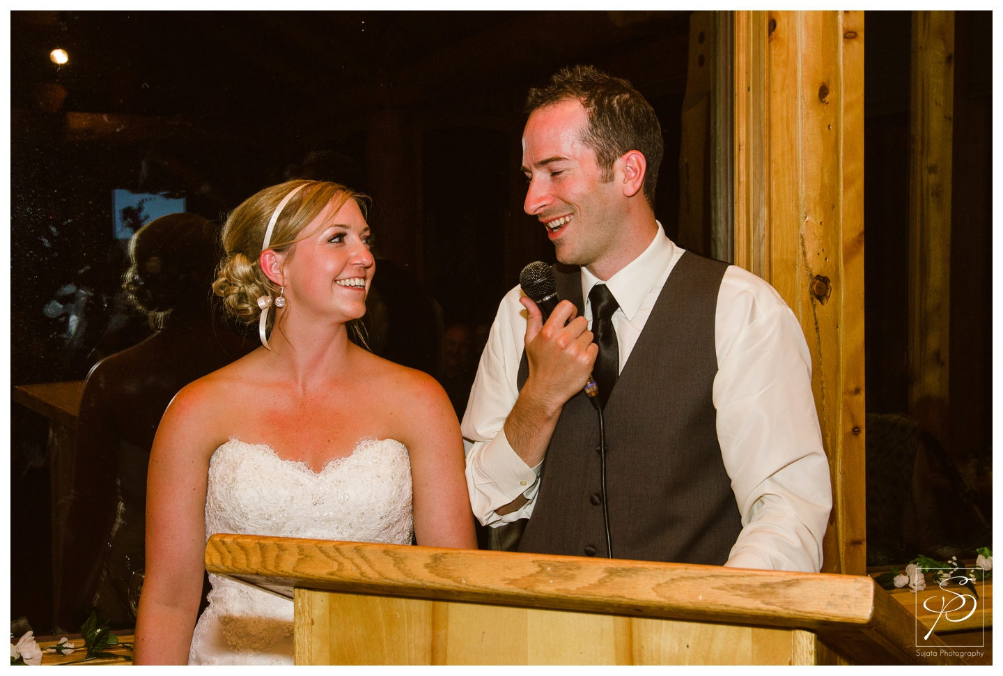 Bride and groom giving speech at Lake Louise ski hill wedding reception