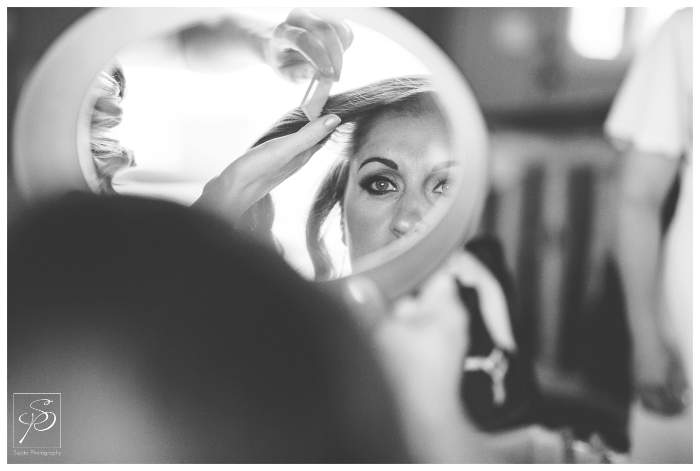 Black and white bridal portrait in a mirror