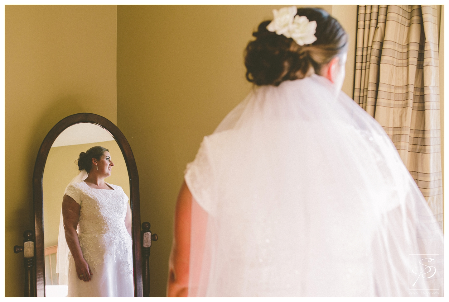 Bridal portrait in mirror at acreage wedding