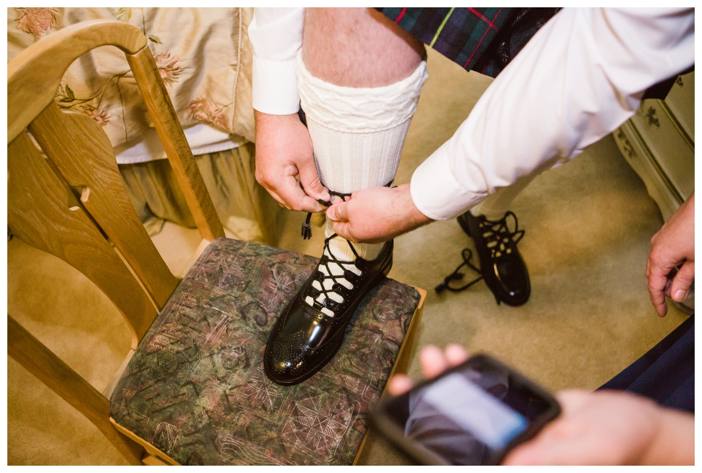 Groom dressing in traditional Kilt