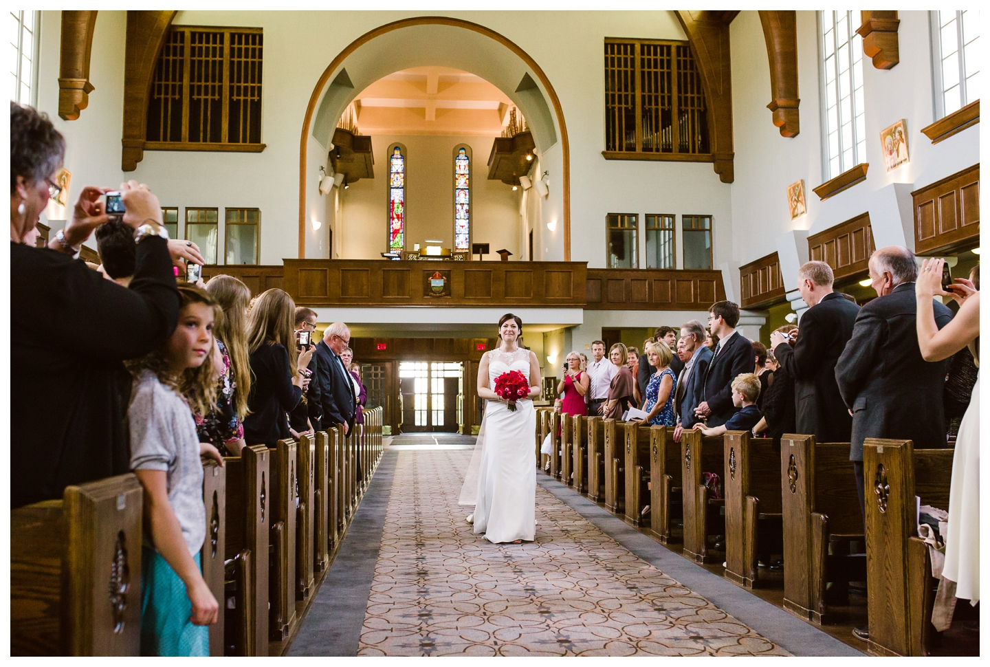Bride walking down cathedral aisle