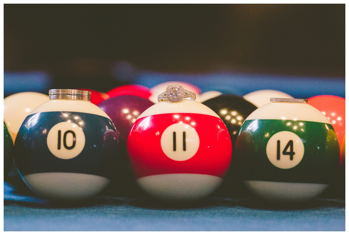 Pool balls with wedding rings