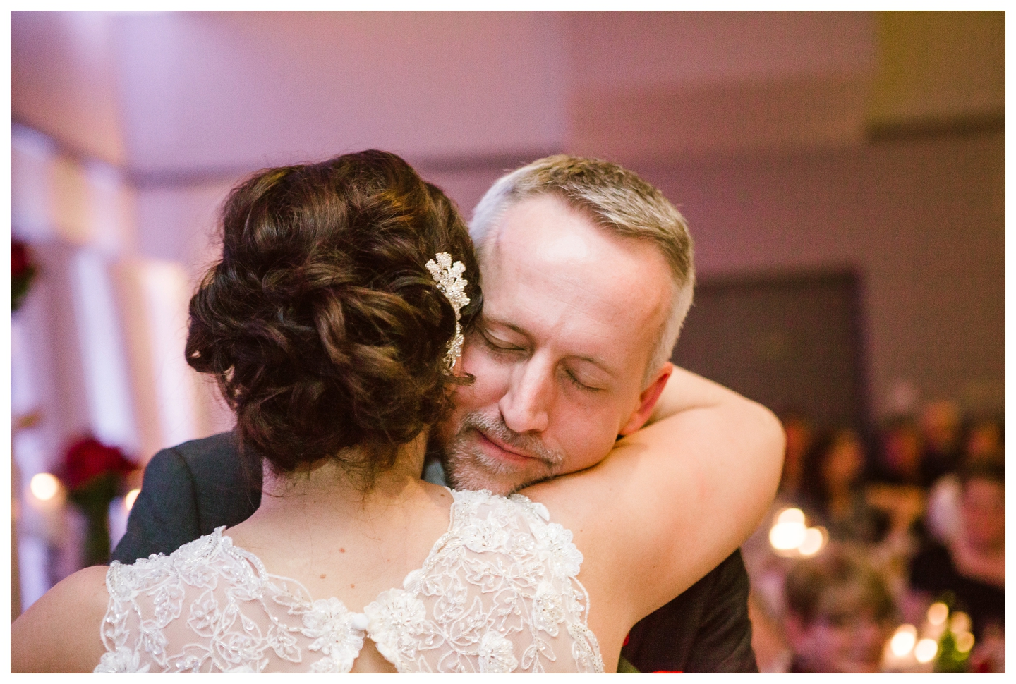 Bride and Groom hugging during wedding reception