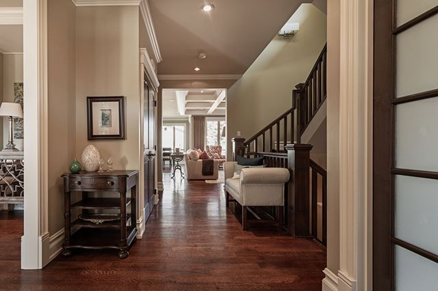 Peeking into all the exciting spaces in this home through the dramatic entryway hallway.⁣ .⁣ .⁣ #yycrealestate #yycre #yycdesign #realestate #yychomes #yycliving #calgary #calgaryhomes #realestatemarketing #marketing #interiordesign #yycmarketing #luxuryliving