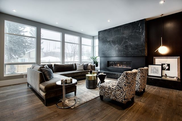 This moody living room was a cozy place to be on a snowy winter day.⠀ .⠀ .⠀ ⠀  #homedecor #interiorphotography #yycinteriors #calgaryphotographer #architecturelovers #luxury #luxuryhomes #homedesign #luxurylifestyle #luxurylife #luxuryrealestate #customhomes