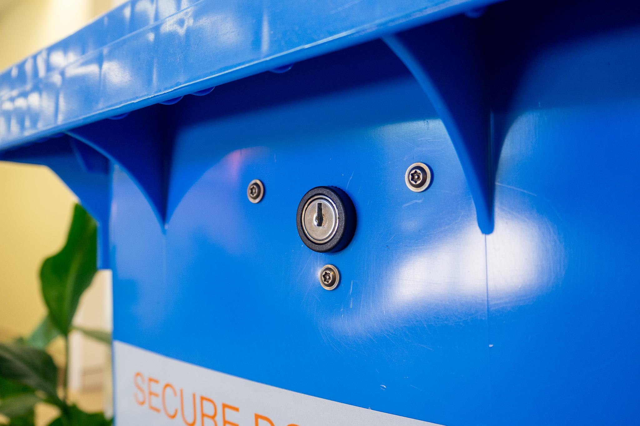 Lock on secure shredding bin