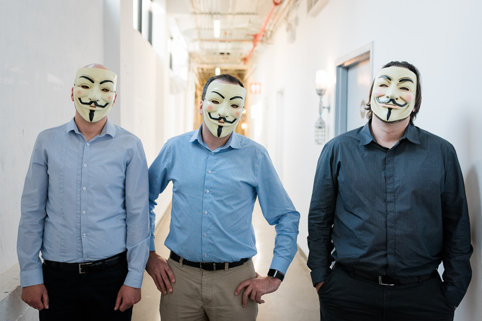 Cybeats founding members in Guy Fawkes/Anonymous masks. From left to right: Vladisklav Kharbash, Dmitry Raidman, and Peter Pinsker.