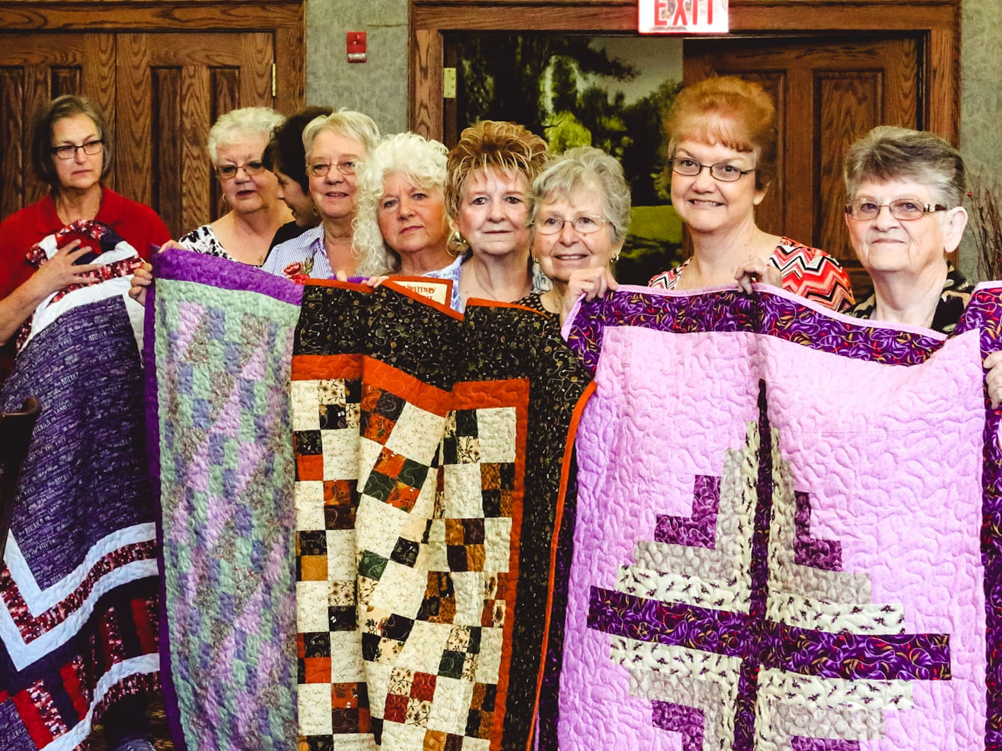 Group+holding+quilts.jpg