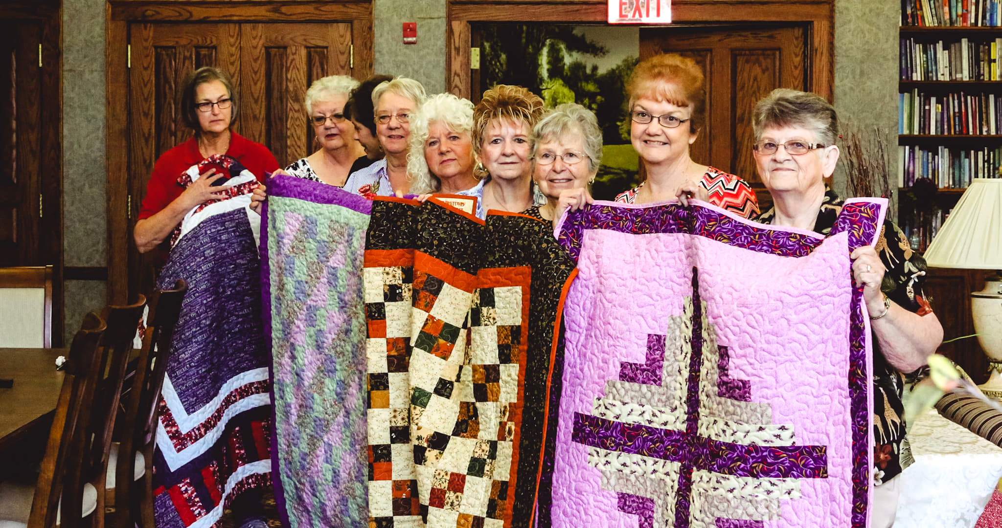 Group holding quilts.jpg