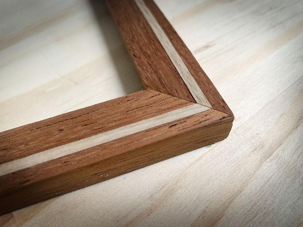 Merbau and oak handmade inlaid frame.