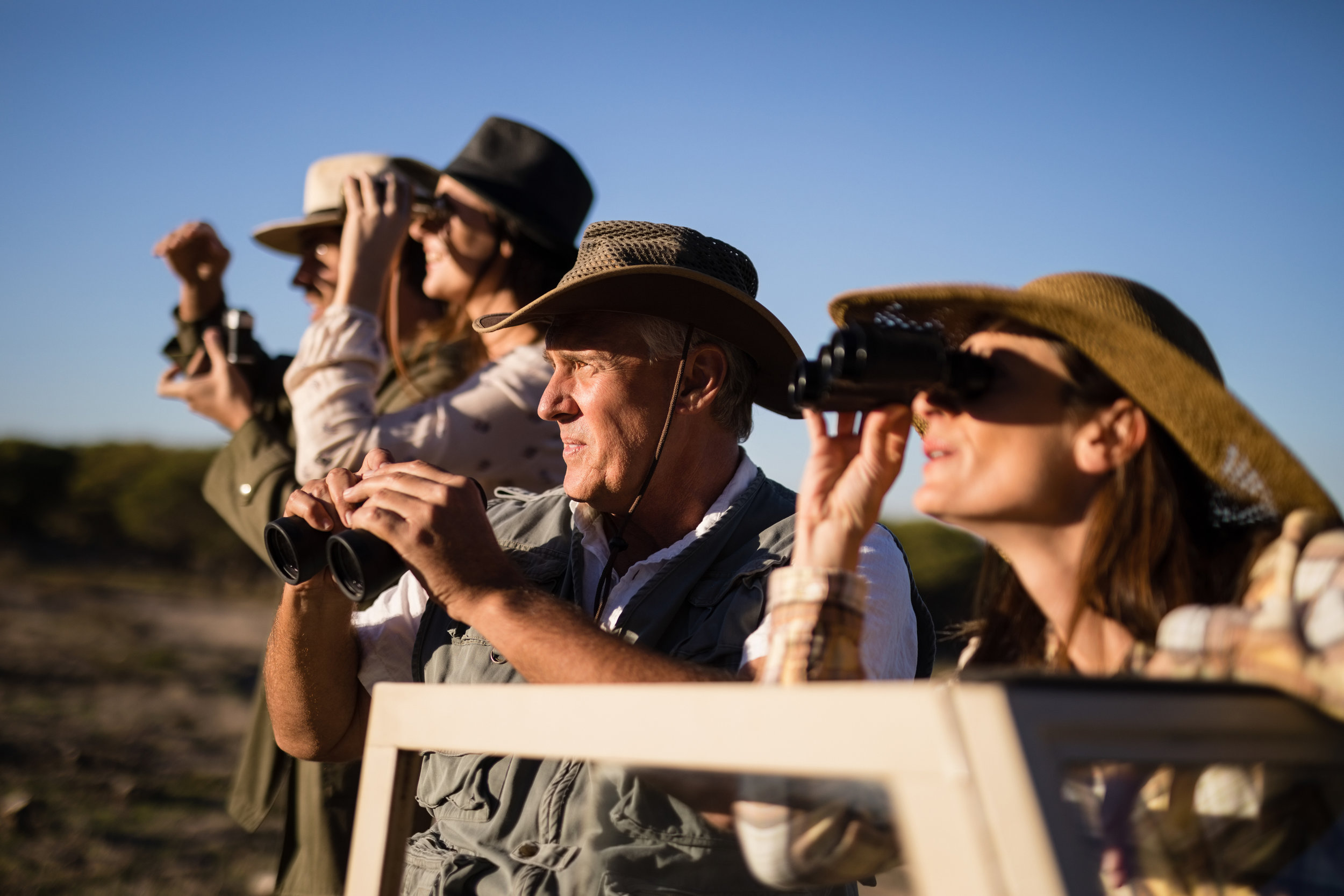 Friends-looking-through-binoculars-during-safari-vacation-879922462_3869x2579.jpeg