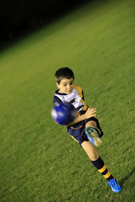 Littlie kicking ball fast blurry.jpg