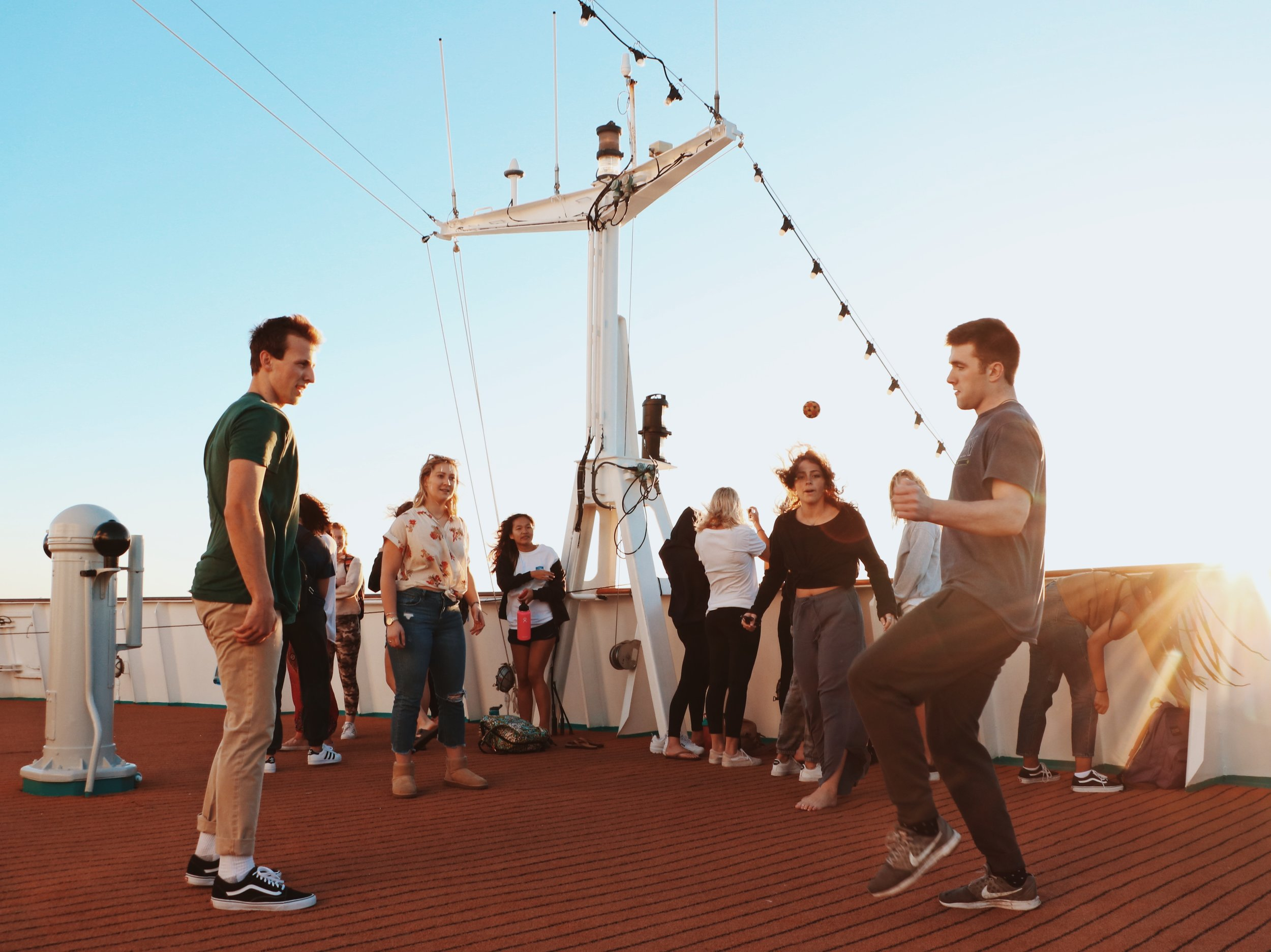 Students wait for sunset by playing hackeysack on the Lido deck. This is a popular gathering place for outdoor activities such as yoga and stargazing.