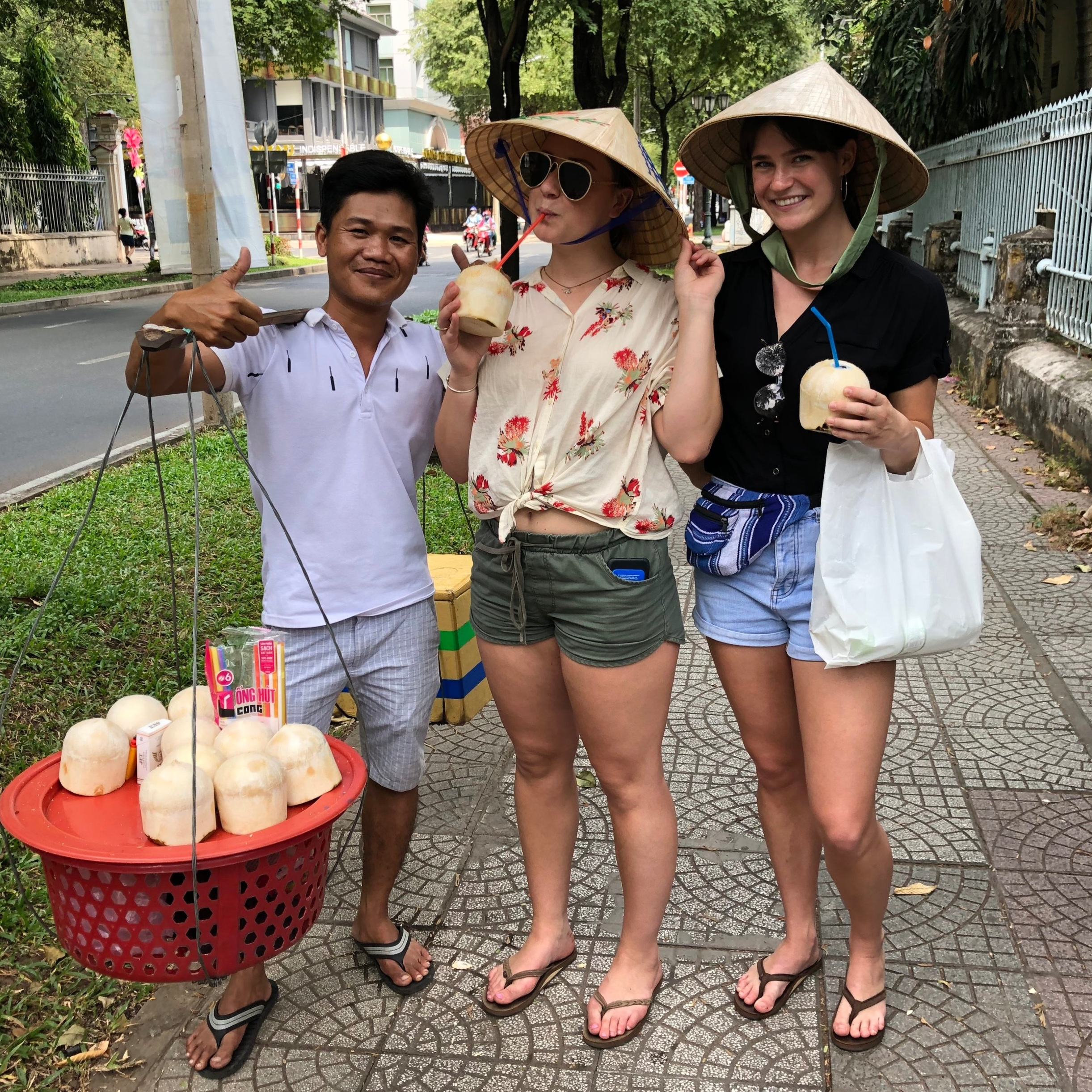 Sophia and me posing with our new coconut friend. The rice hats instantly gave our tourist identities away.
