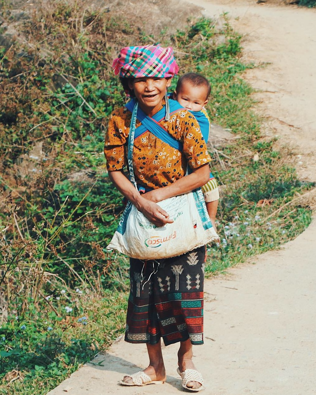This is one of my all-time favorite photos. This woman and her baby were walking up from the river as we made our way down and she gave me one of the most authentic smiles I have ever seen.