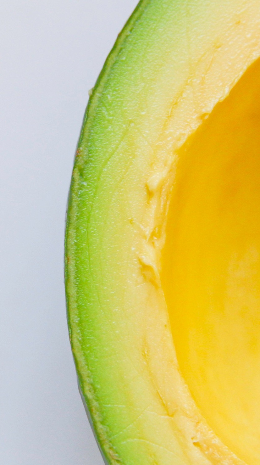 iii. avocado - The dark New England winter has moved into my apartment, an unwanted resident that seeps through the outdated furnaces. I now have to get avocados imported to welcome sun into my home, it's easier than exposing the space to a warmth that's never really there.I sometimes feel bad about eating them in the winter. But I've become addicted. I insert my knife into the top and glide the fruit around in a circular motion as the blade separates the textured skin to reveal a green type of heaven. One side, absent. The other, a bulging seed. I take joy in the moments where I drive the sharp edge of the knife into the core, twisting and freeing it from its one purpose: providing life.We don't speak anymore.I've driven wedges of blades in between many things to scorch the burn. Like eye-contact. Or knowing what I want, how to want, not saying what I mean, feeling joy when its received.Father moved to Texas—separating fruit from loins is a difficult process, but he managed well. Mastered it, actually.When I see father daughter dances at weddings I sneak to the bar and order an extra martini. When I think of inventions, like telephones or planes, I wonder how he never found out about their practicalities.I can rely on some things. Like the assurance that avocados are green in the middle, sometimes yellow. They always have pits that are ripped out before enjoyment. I stopped making guacamole years ago. I hated salvaging the seed to keep the aesthetic. When air dims the fruits vibrancy, it turns color. I was tired of taking a spoon to the insides and stirring in the bad with the good. I stopped buying lemons to preserve perfection.