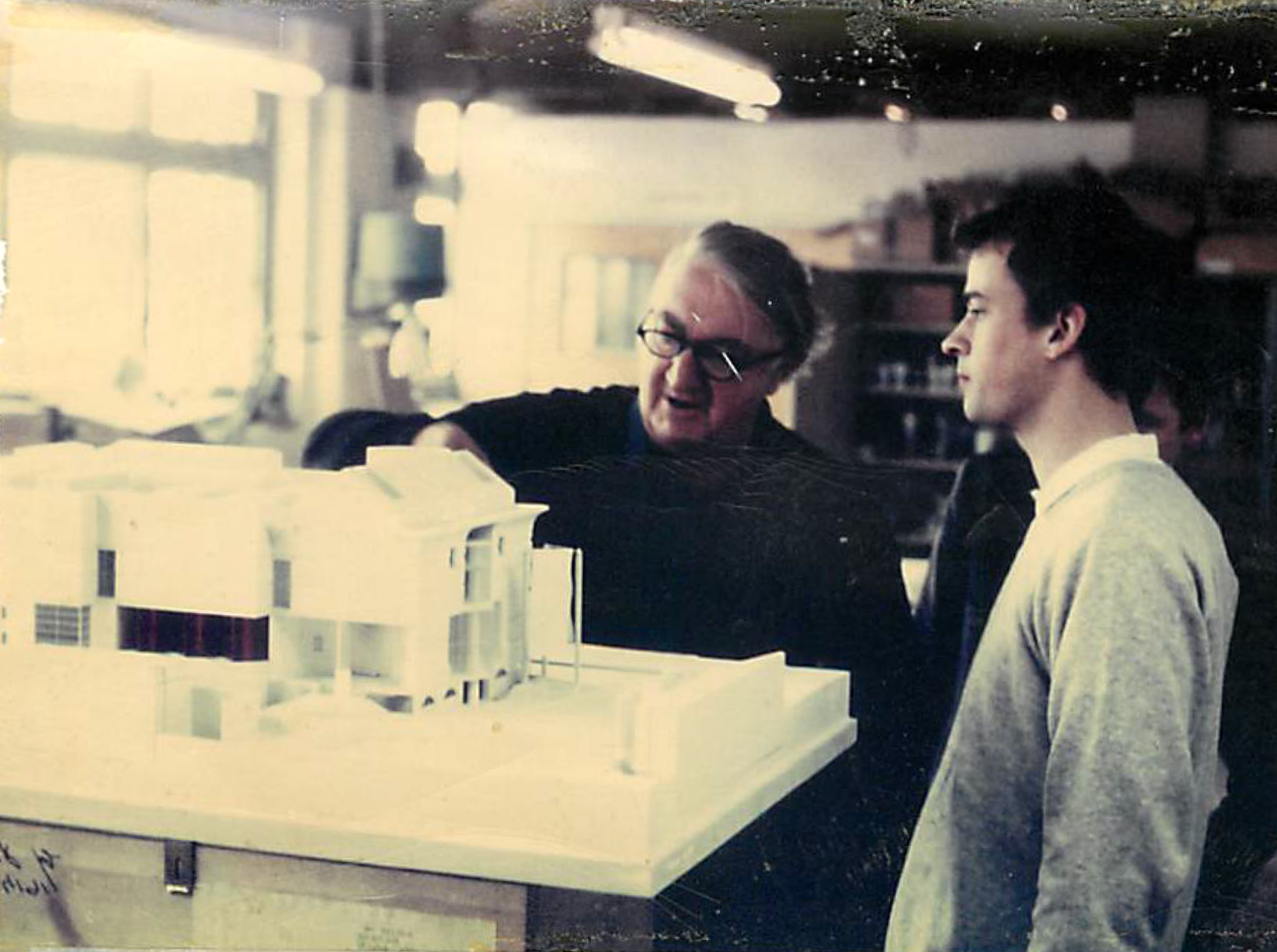 Modelmaking tradition: James Stirling inspects a model with a young(er!) David Gomm, now a Director at Kandor Modelmakers.