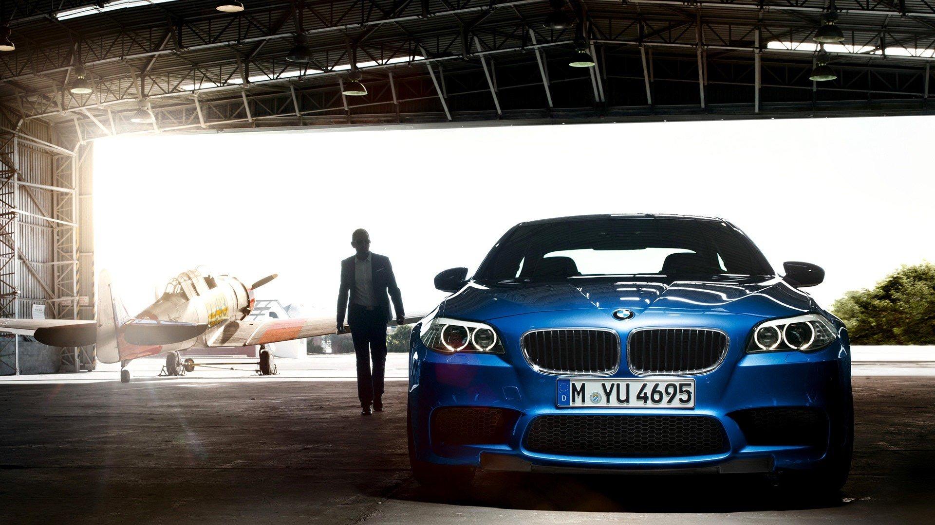 bmw-hangar-plane-blue-wallpaper-wallpapers-walls.jpeg
