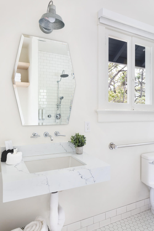 bathroom sink, mirror and toilet