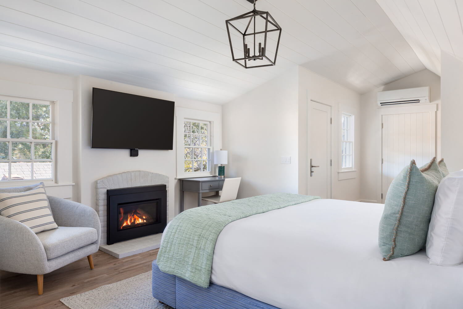 suite with a fireplace, tv and chair