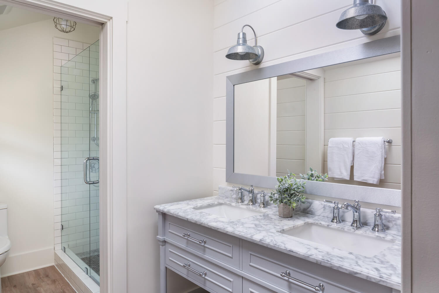 suite bathroom with marble counter
