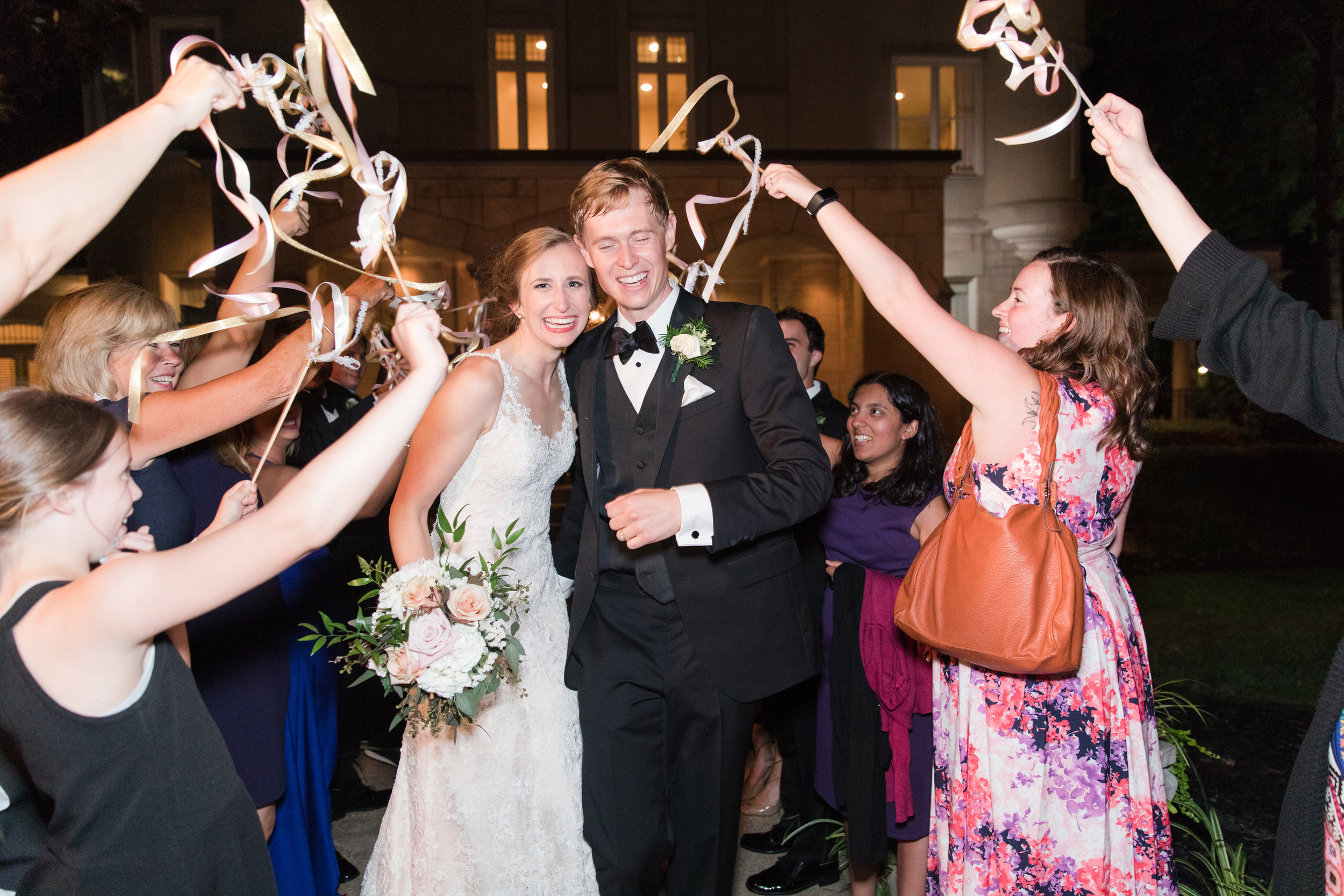 Photo of a ribbon-wand wedding send off by    Abby Breaux Photography   .