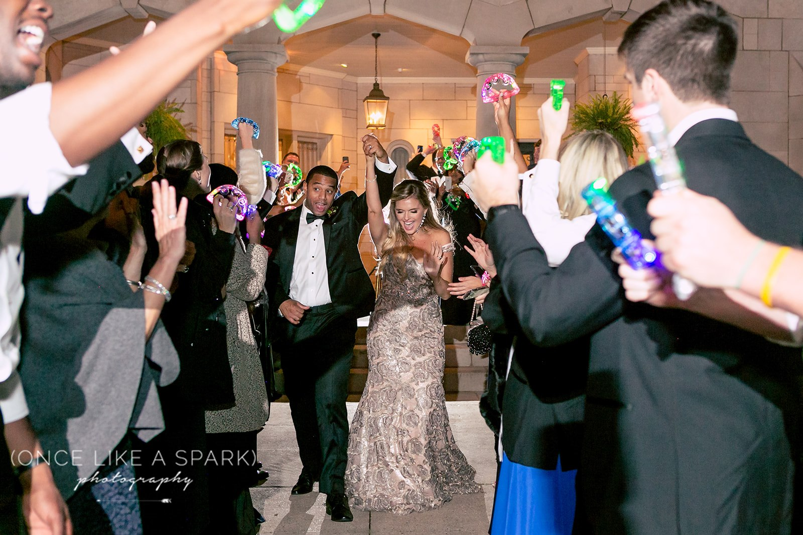 Photo of a light-up tambourine wedding send-off by    Once Like A Spark Photography   .