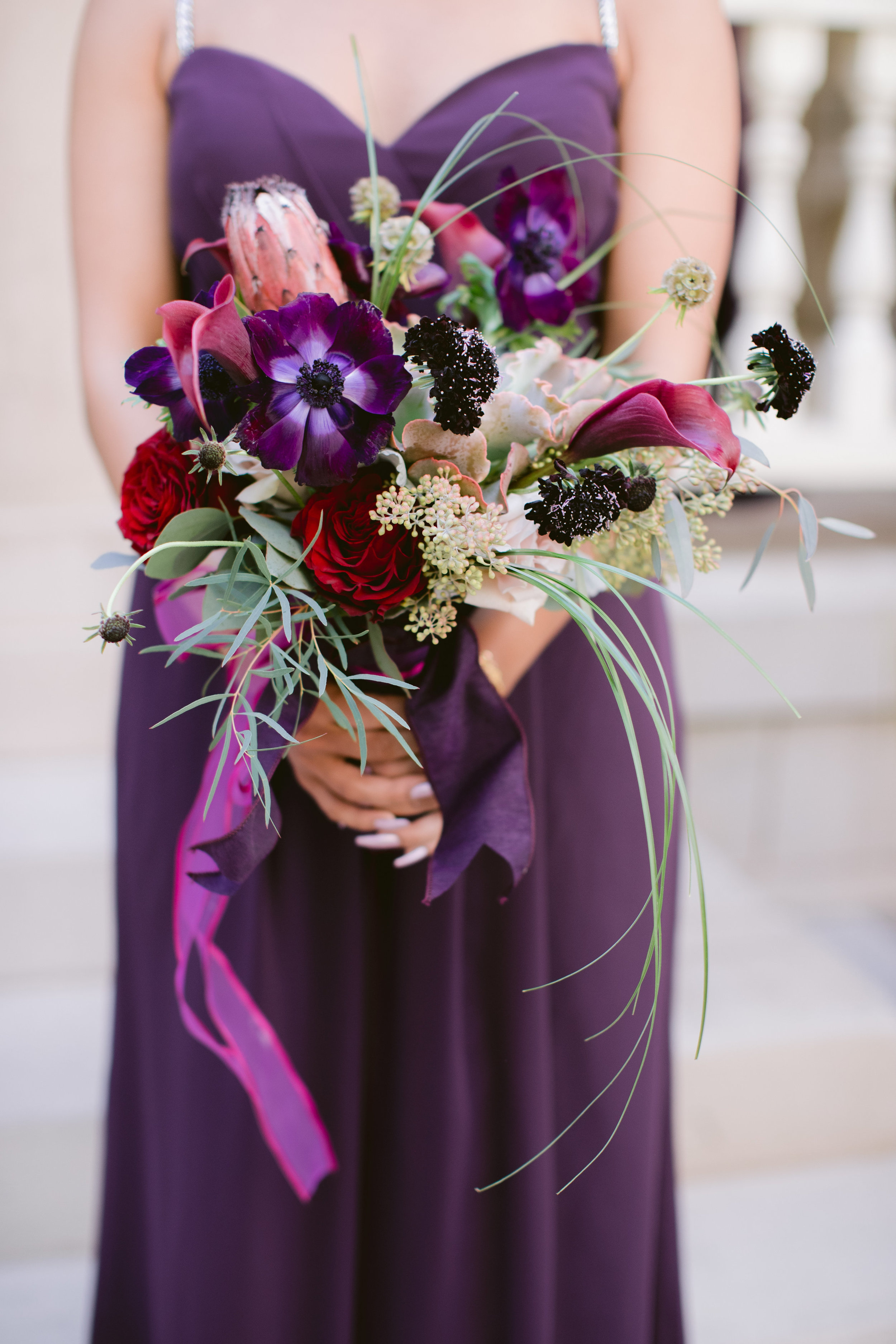 Purple bridesmaid bouquet by 2000 A.D. Inc. Photo by Laura Stone Photography.