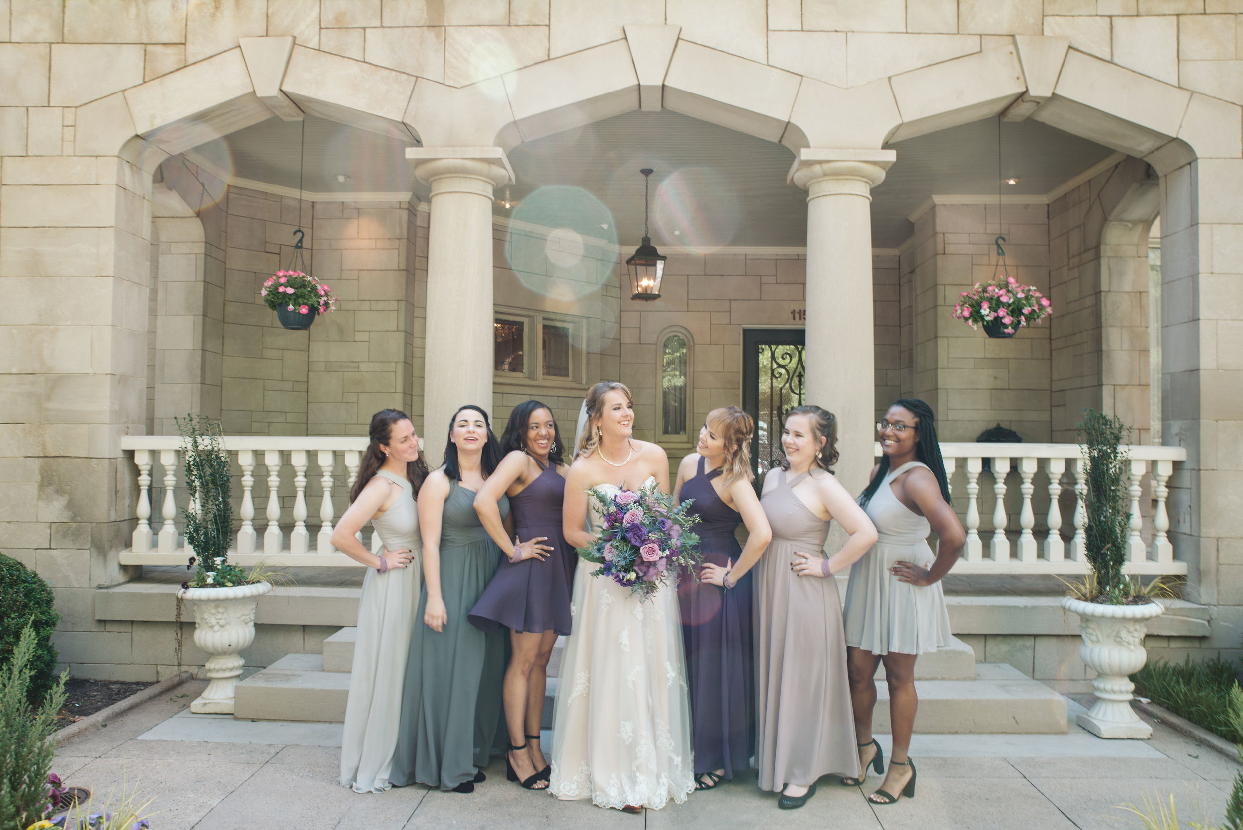 Bride and bridesmaids strike a pose in front of the Wimbish House, Atlanta's premier wedding and event venue.