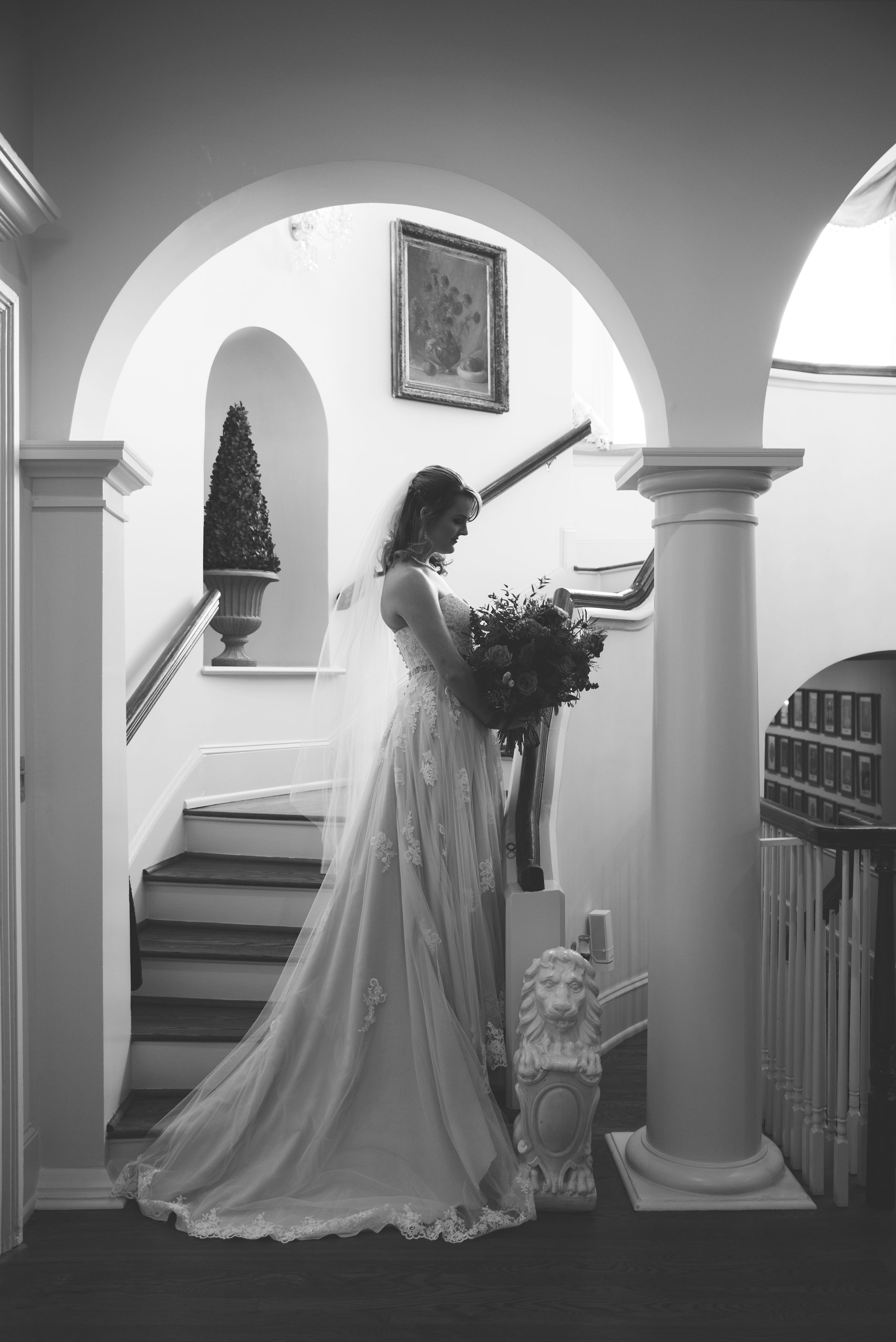 Bride poses on the staircase at the Wimbish House in midtown Atlanta.