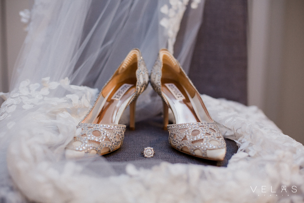 Bridal shoes, veil, and engagement ring.