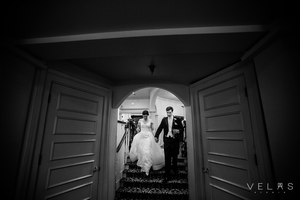 Bride and groom entering the ballroom.
